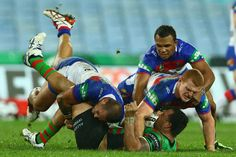 Jeff Lima of the Rabbitohs is tackled during the round 12 NRL match between the South Sydney Rabbitohs and the Newcastle Knights at ANZ Stadium on June 1, 2013 in Sydney, Australia.