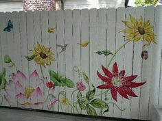 I love the beautiful mural painted by Renee Fox. It brings beauty and an upbeat whimsy to a previously white boring fence. Garden Fence Art, Garden Mural, Backyard Fences, Diy Fence, Flower Mural, Flower Fence, Outdoor Art, Yard Art, Garden Projects
