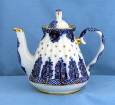 Teapot and a wedding Lomonosov Russian porcelain bridesmaid teapot  Lomonosov presents this lovely Porcelain Teapot with 24K gold trim. It features a unique shape that is reminiscent of a bridesmaid dress or wedding gown. The combination of blue and white mixed with dots of gold creates a stunning look.