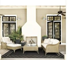 Love the white outdoor fireplace and the house color