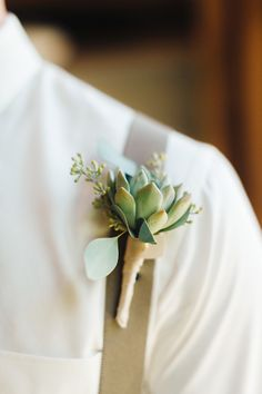 Simple Succulent Boutonniere --  See the wedding on SMP: http://www.StyleMePretty.com/2014/05/26/romantic-garden-wedding-at-the-rockford-art-museum --  Photography: RyanTimmPhotography.com