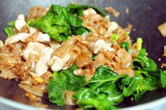 Pad See Ew is a noodle dish made by stir frying wide rice noodles with soy sauce and adding in egg, thinly sliced chicken, and Chinese broccoli.