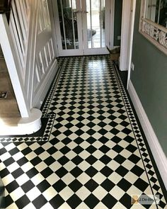 Classic checkerboard hallway design and border. All cut from Marmoleum.