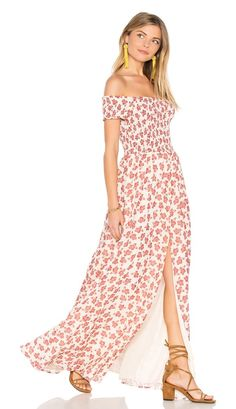 Henderson Maxi Dress by Tularosa. Sweeten up your day look in the Henderson Dress by Tularosa. Crafted from an off-the-shoulder smocked bodice, it crea...