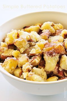 Buttered potatoes are a simple, classic, and comforting side dish recipe from addapinch.com