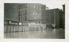 """Cincinnati, Ohio, 1937 flood, from the collection of Carita and Paul Kollman: Pearl and Elm Streets, January 30, 1937 """"Sign reads: no interference from high water. Water reached line shown on picture"""""""