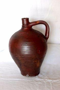 Cruche à l huile en terre cuite ancienne
