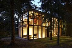 Berlin's Passive Minimum House is a modernist glass residence in the woods