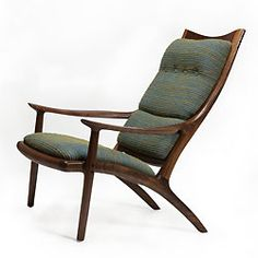 I have a Sam Maloof chair I inherited from my aunt, which is almost like this...