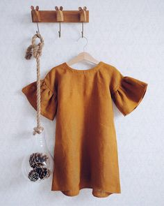 Linen Dress with short sleeves for girls, flax clothing for a baby, dress with flounces Source by etsy Toddler Dress, Toddler Outfits, Kids Outfits, Baby Outfits, Girl Toddler, Baby Girl Fashion, Kids Fashion, Fashion Games, Toddler Fashion