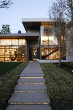 'Love the simple contrasting low shrubbery along the lighted front lead-walk. Very original. Brentwood Residence Interiors by MLK Studio. (Click on photo for high-res. image.) Originally blogged here: http://www.contemporist.com/2011/03/01/brentwood-residence-interiors-by-mlk-studio/bh_010311_01/