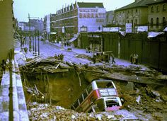 WW2 1940 Blitz Balham    1940 - Scene of Balham London after heavy German air raid bombing attacks during the Battle of Britain.    On 14 October 1940, a bomb penetrated the road and tunnel at Balham tube station, blew up the water mains and sewage pipes, and killed 68 people.    At Bank station a direct hit caused a crater of 120 ft by 100 ft on 11 January 1941, the road above the station collapsed and killed 56 occupants.