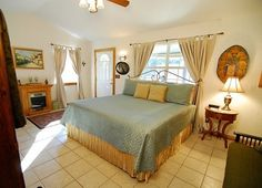 Airy light blue bedroom at the Acorn Hill Bed & Breakfast in New Braunfels Texas