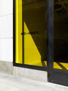 """Together with Axel Arigato creative director Max Svärdh, the architect was keen to deliver a """"new experience for customers"""", doing so through the introduction of yellow-coloured accents."""