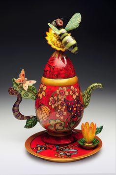 Janet and Jay O'Rourke, Cocoa FL - salvaged wood, turned and carved vessels.