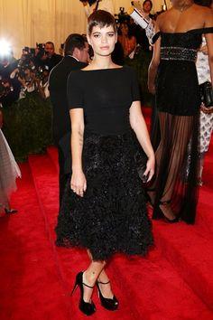 Pixie Geldof in a Moschino black dress with ruffled skirt. #MetGala #2013