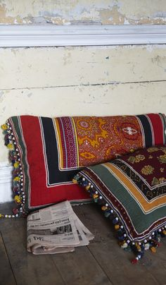 Hindustani Floor Cushions : Gorgeous oblong floor cushions made from vintage materials and trimmed with beads, tassels and ric-rac.