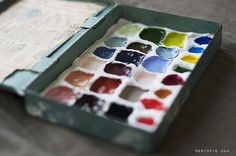 Making a DIY traveling watercolor palette. Use a tin or other container, and make the wells for the paint from clay.