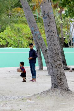 2 local kids playing with a ball #maldives #kids #children