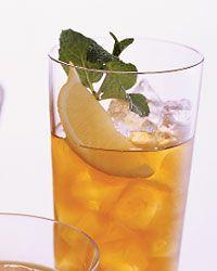 Gentleman Johnson  Ice  2ounces bourbon  5ounces unsweetened iced tea  1mint sprig  1 lemon wedge  1/2ounce Cointreau or other triple sec