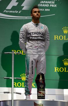 A subdued Lewis Hamilton during the British national anthem at the 2014 Japanese Grand Prix. #F1