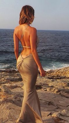If ever the need to wear an elegant evening dress on a beach, do it like this! Nice twist detail
