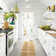 Clever design tricks make even a narrow galley kitchen seem roomy. Homeowner Trish Becker wisely installed smaller-than-standard appliances into her renovated Bahamian cottage to save countertop space in the busiest room of the house.