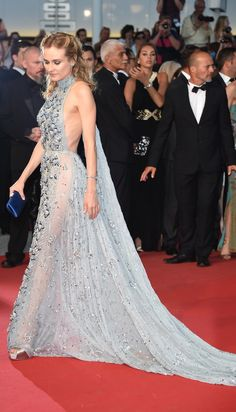 Diane Kruger showed off her own version of the naked dress: a sequin embellished halter number with side panels and a long train that draped around her. She completed her look with a blue satin clutch and diamond jewels.