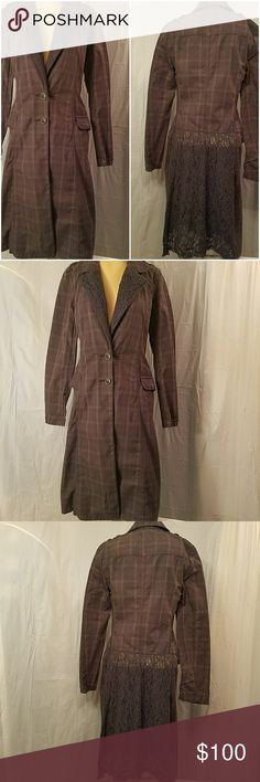 """Free People in grey.. duster trench coat. The stock photo is darker...mine is a dark grey and is hard to photograph  ..thr pictures do not do it justice!    Long grey plaid cotton jacket with lace.  2 front buttons and 2 pockets.   Bought a couple of years ago but never worn.  Beautiful interesting jacket. Jacket measures on a flat lay...40"""" long from shoulder to hem and 17"""" from armpit to armpit. Free People Jackets & Coats Trench Coats"""