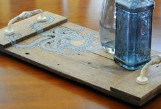 Serving tray hand crafted from reclaimed wood with a hand painted detailed octopus.