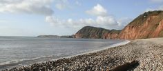 Part of the East Devon World Coast Heritage Site, Sidmouth Beach is recognisable for its dramatic red cliffs. #sidmouth #devonbeaches #bluechipholidays