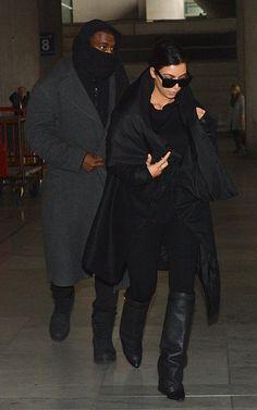 Kim Kardashian wearing Givenchy Shark Lock Fold Over Wedge Boots in Black Celine Matrix Top Heavy sunglasses