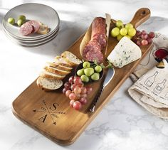 This beautiful, generously sized cheese board is ready to cut and present delicious cheeses, meats and hors d'oeuvres for your party, laser etched with your choice of personalization.