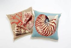 Nautical Needlepoint Pillows: Elizabeth Bradley Home Shells Red Coral on Sand and Shells Nautilus on Duck Blue | CoastalLiving.com