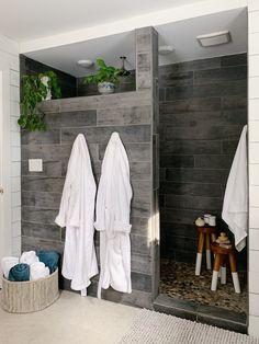 Walk-in Wood Tile shower with pebble floor Wood Tile Shower, Tile Walk In Shower, Master Bathroom Shower, Small Bathroom, Wood Bathroom, Hidden Shower, Walk Through Shower, Bathroom Ideas, Tiled Showers