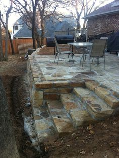 Hillman Outdoor Living Raised Stone Patio With Steps. #patio #backyard