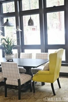 Love this Ethan Allen yellow wingback at the dining room table!