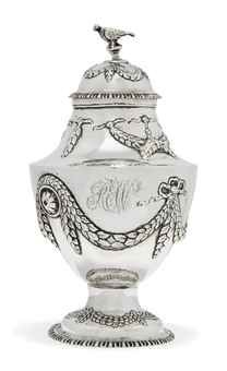 A GEORGE III SILVER VASE-SHAPED TEA CADDY, MARK OF R.S, LONDON, 1771, With gadroon borders, the sides chased with ribbon-tied laurel leaf swags and rosettes, bird finial, on pedestal foot, one side engraved with the monogram REW