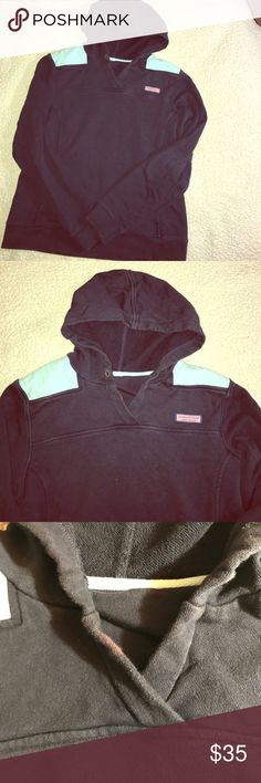 Vineyard Vines hooded sweatshirt Light blue along the shoulders on a navy base. A few very small bleach stains as shown in pictures. Hardly noticeable at all! Front pouch pocket. Terry cloth lined. Great to throw on during the cool summer nights! There is no size on the tag - pretty sure it's a medium. Measures 19 inches from armpit to armpit when laid flat and about 23 inches from shoulder to hem. Sits right at the hips. Vineyard Vines Sweaters