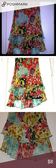 Flowy & Colorful Skirt Beautiful flowy & colorful skirt. Previously owned but in great condition. A little higher in front than the back. latina Skirts High Low