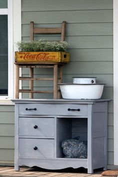 Welcoming Wash Stand: I painted and replaced the hardware on an vintage washstand and placed it on my farm-house front porch! www.cedarhillfarmhouse.com