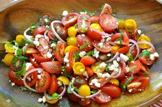 Heirloom Tomato Salad with feta, onion and basil ~ it just screams of summer! www.asouthern-soul.blogspot.com