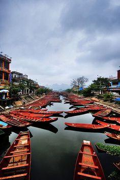 Boats on the Yen Vi River, Vietnam