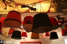 love these hanging lampshades ... I want to do this somewhere in my house