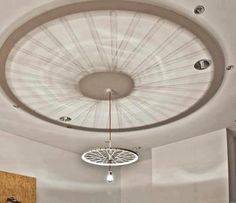 Re-purpose a bike wheel to make a cool light fixture. You'd want a drum shade and a diffuser on the bottom, but love that ceiling projection.