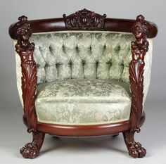 "Carved Mahogany Arm Chair. Women figures, claw feet. Chair Ht. 34"" W 36"". A Buffalo, NY Estate."