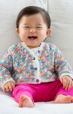 """Cute, cute baby wearing a """"Butterfly Days"""" Baby Cardigan. One can get the Free Crochet Pattern from Red Heart Yarns"""