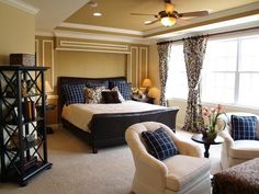 An example of a ceiling fan light in combination with recessed lights in a master bedroom