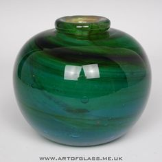 Handcrafted vase in the typical blue green ochre Mdina colours with dark swirls Made by Mdina Glass on the island of Malta Circa 1970 Measures 12 3cm