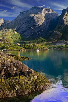 Summer in Jektvik  Kilboghavn in Nordland, Norway, is a beautiful place situated between stall mountains and the green sea water.